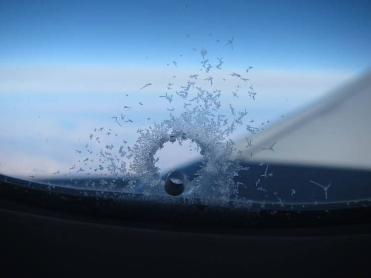 Tiny Holes Drilled In Airplane Windows