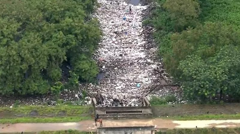Man Walks On River Due To Huge Amount Of Rubbish Collected