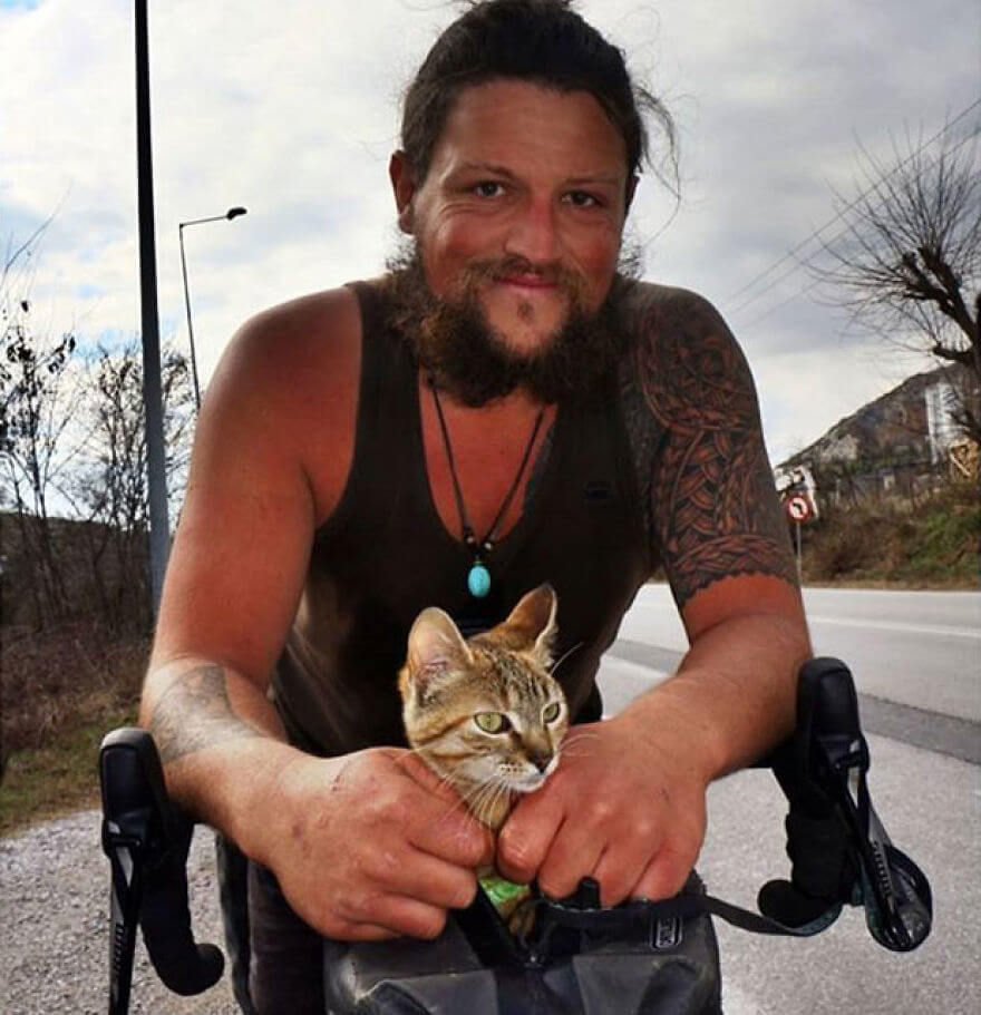 Cyclist traveling with a kitten